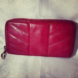 Magenta leather Ted Baker zip around clutch wallet